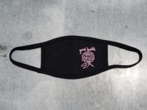 "handmade fair trade black face mask with a soft pink screen printed design on the right-hand side of the mask of a chrysanthemum with the text, ""good health"" above it in cursive."